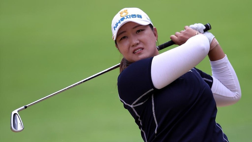 South Korea's Mirim Lee watches her shot during the second round of the Women's British Open at Woburn Golf Club, in Woburn, England, Friday July 29, 2016. (Nick Potts/PA via AP)