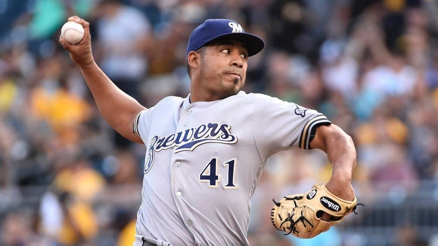 Milwaukee Brewers Junior Guerra (41) throws a pitch in the first inning of a baseball game against the Pittsburgh Pirates in Pittsburgh, Tuesday, July 19, 2016. (AP Photo/Fred Vuich)