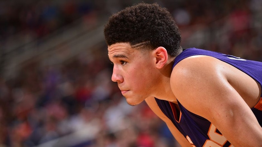 PHOENIX, AZ - MARCH 9: Devin Booker #1 of the Phoenix Suns during the game against the New York Knicks on March 9, 2016 at Talking Stick Resort Arena in Oakland, California. NOTE TO USER: User expressly acknowledges and agrees that, by downloading and or using this Photograph, user is consenting to the terms and conditions of the Getty Images License Agreement. Mandatory Copyright Notice: Copyright 2016 NBAE (Photo by Barry Gossage/NBAE via Getty Images)