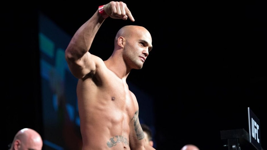 LAS VEGAS, NEVADA - JANUARY 01: UFC welterweight champion Robbie Lawler steps on the scale during the UFC 195 weigh-in at the MGM Grand Conference Center on January 1, 2016 in Las Vegas, Nevada. (Photo by Jeff Bottari/Zuffa LLC/Zuffa LLC via Getty Images)