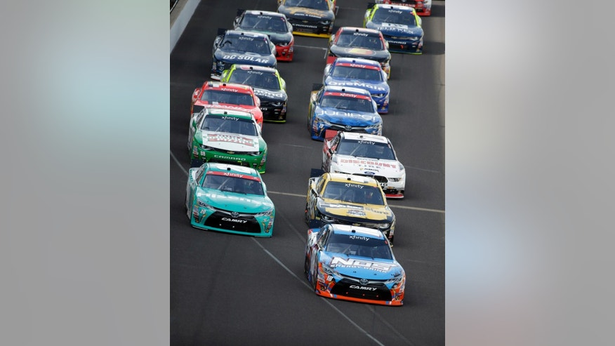 Kyle Busch (18) leads the field into the first turn on the start of the NASCAR Xfinity auto race at Indianapolis Motor Speedway in Indianapolis, Saturday, July 23, 2016. (AP Photo/Michael Conroy)