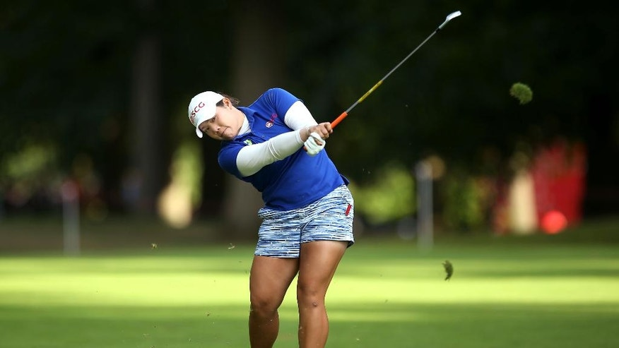 Thailand's Ariya Jutanugarn in action during day three of the Women's British Open at Woburn Golf Club in Woburn, England, Saturday, July 30, 2016. The Women's British Open was established by the Ladies' Golf Union in 1976 and was intended to serve as the women's equivalent of The Open Championship. (Steve Paston/PA via AP)