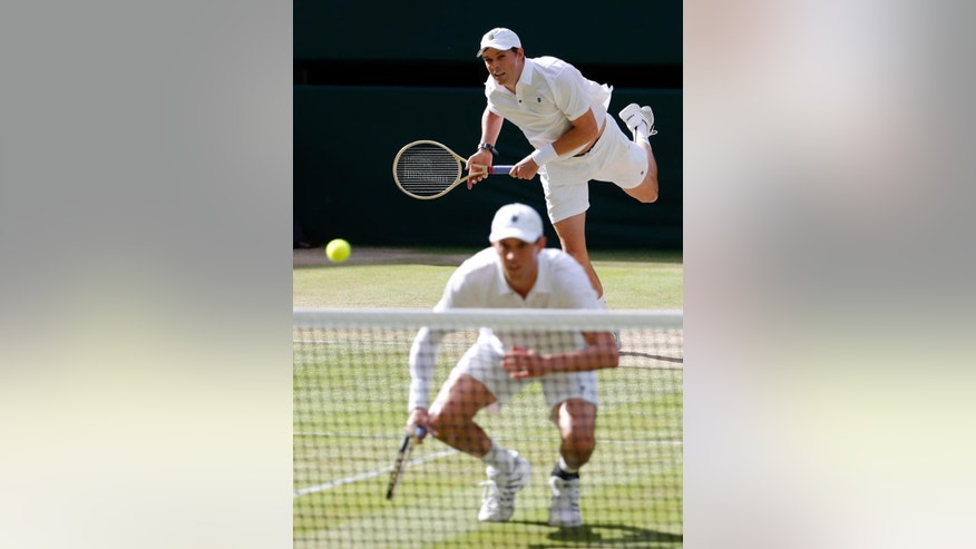 "File-This July 5, 2016, file photo shows Mike Bryan, front, and Bob Bryan of the U.S return to Nenad Zimonjic of Serbia and Radek Stepanek of the Czech Republic during their men's doubles match on day eight of the Wimbledon Tennis Championships in London. Bob and Mike Bryan will not defend their Olympic doubles title in Rio, citing health concerns. The twins announced their withdrawal on their Facebook page Saturday, July 30, 2016, saying that as ""husbands and fathers, our family's health is now our top priority."" They didn't mention the Zika virus, which has been linked to birth defects. (AP Photo/Ben Curtis, File)"