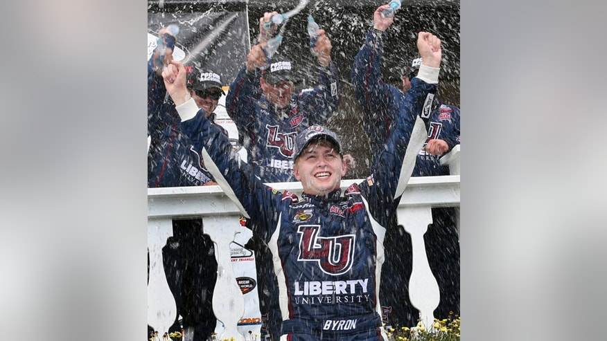 William Bryon (9) celebrates in Victory Lane with his crew after winning the NASCAR truck series Pocono Mountains 150 auto race, Saturday, July 30, 2016, in Long Pond, Pa. (AP Photo/Mel Evans)