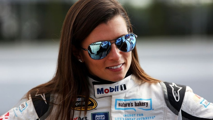 LONG POND, PA - JULY 29: Danica Patrick, driver of the #10 Mobil 1 Chevrolet, stands on the grid during qualifying for the NASCAR Sprint Cup Series Pennsylvania 400 at Pocono Raceway on July 29, 2016 in Long Pond, Pennsylvania. (Photo by Adam Glanzman/Getty Images)