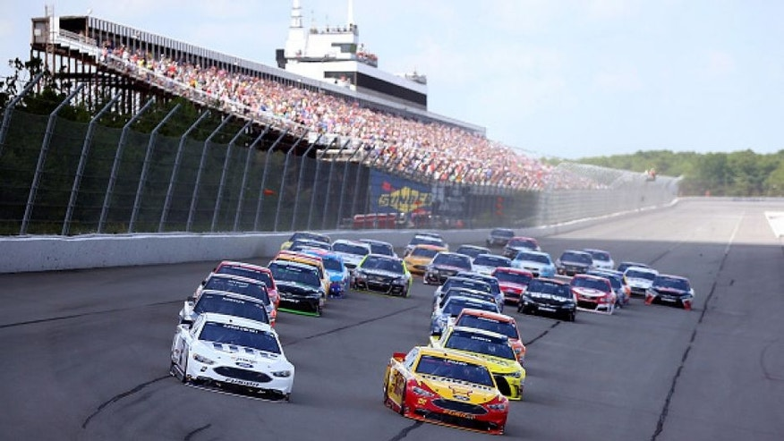 """LONG POND, PA - JUNE 06: Brad Keselowski, driver of the #2 Miller Lite Ford, and Joey Logano, driver of the #22 Shell Pennzoil Ford, lead the field into turn one to start the NASCAR Sprint Cup Series Axalta """"We Paint Winners"""" 400 at Pocono Raceway on June 6, 2016 in Long Pond, Pennsylvania. (Photo by Sean Gardner/Getty Images)"""
