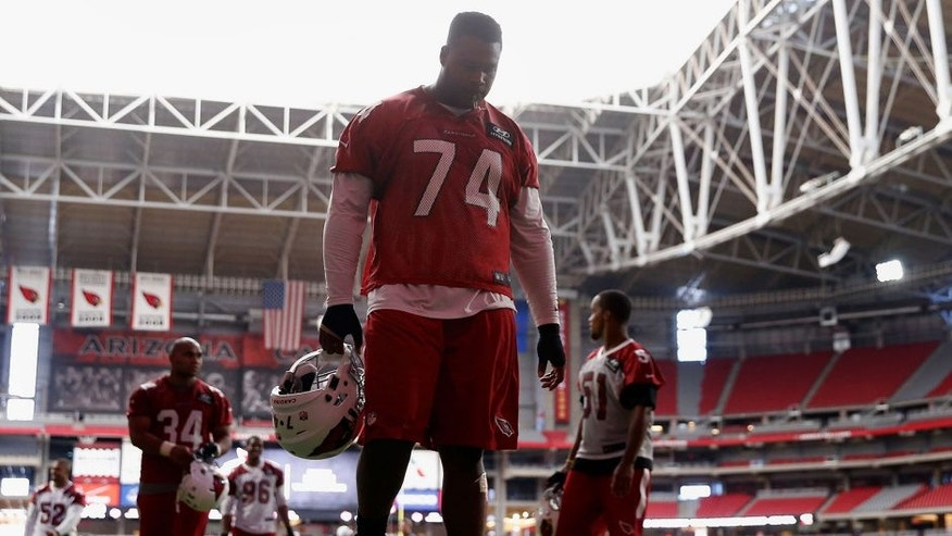 GLENDALE, AZ - AUGUST 02: Offensive tackle D.J. Humphries #74 of the Arizona Cardinals walks off the field following the team training camp at University of Phoenix Stadium on August 2, 2015 in Glendale, Arizona. (Photo by Christian Petersen/Getty Images)