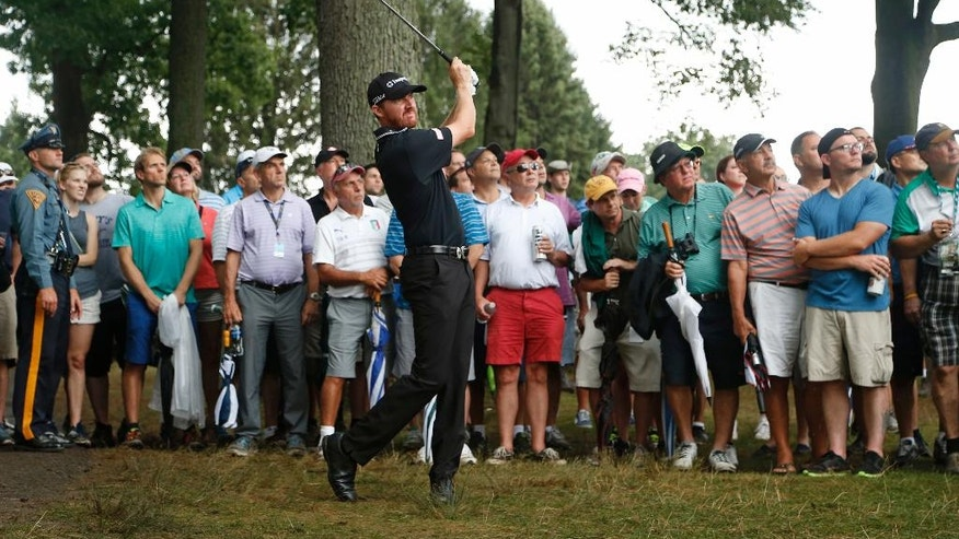 Jimmy Walker hits from the rough on the third hole during the final round of the PGA Championship golf tournament at Baltusrol Golf Club in Springfield, N.J., Sunday, July 31, 2016. (AP Photo/Mike Groll)
