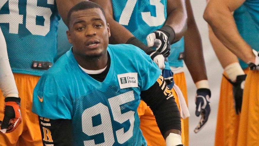 FILE - In this June 2, 2014, file photo, Miami Dolphins defensive end Dion Jordan (95) is shown during football practice in Davie, Fla. Dolphins defensive end Dion Jordan has been reinstated by the NFL on a conditional basis after sitting out last season for his latest violation of the league's substance abuse policy. Commissioner Roger Goodell notified Jordan on Friday, July 29, 2016, when the Dolphins held their first training camp practice. (AP Photo/Wilfredo Lee, File)