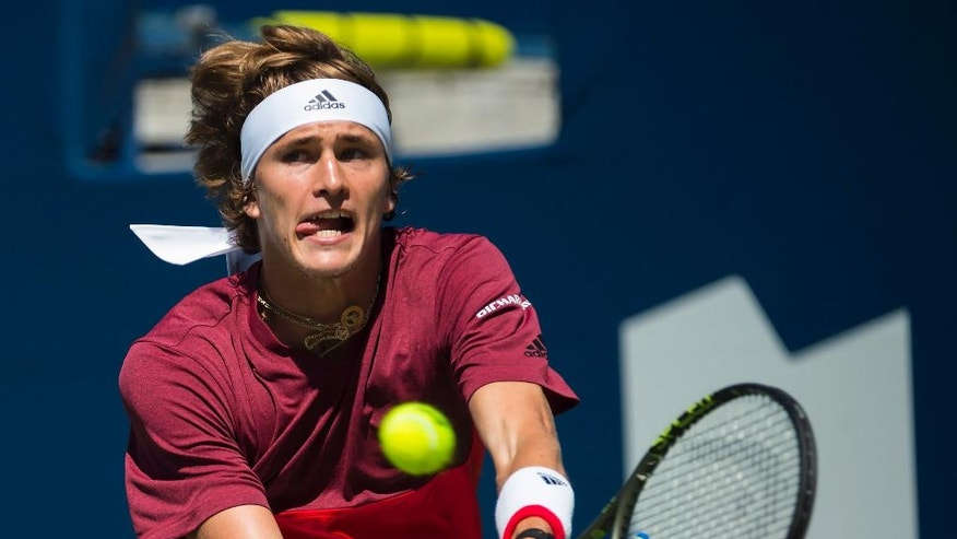 Alexander Zverev of Germany returns the ball against Yen-Hsun Lu of Taiwan during men's second round Rogers Cup tennis action in Toronto on Tuesday, July 26, 2016. (Nathan Denette/The Canadian Press via AP)