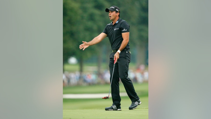 Jason Day reacts to missing a putt on the 18th hole during the final round of the PGA Championship golf tournament at Baltusrol Golf Club in Springfield, N.J., Sunday, July 31, 2016. (AP Photo/Tony Gutierrez)