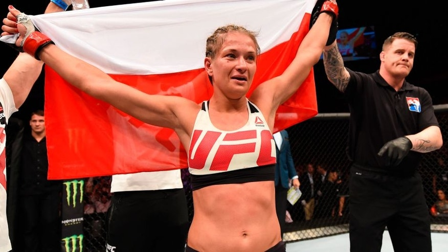 ROTTERDAM, NETHERLANDS - MAY 08: (L-R) Karolina Kowalkiewicz celebrates her victory over Heather Jo Clark in their women's strawweight bout during the UFC Fight Night event at Ahoy Rotterdam on May 8, 2016 in Rotterdam, Netherlands. (Photo by Josh Hedges/Zuffa LLC/Zuffa LLC via Getty Images)