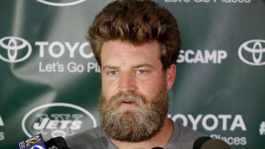 New York Jets quarterback Ryan Fitzpatrick talks to reporters during NFL football training camp, Thursday, July 28, 2016, in Florham Park, N.J. (AP Photo/Julio Cortez)