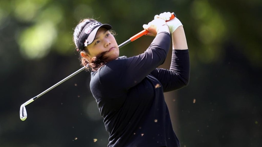 Thailand's Ariya Jutanugarn plays off the fairway during day four of the Women's British Open at Woburn Golf Club, Woburn, England, Sunday July 31, 2016. Ariya Jutanugarn took the Women's British Open lead Saturday at tree-lined Woburn course. (Steve Paston / PA via AP)
