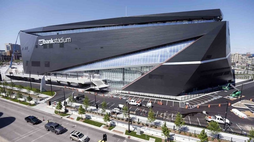In this June 2, 2016, file photo, finishing touches are made on U.S. Bank Stadium, the new home of the Minnesota Vikings NFL football team in Minneapolis.