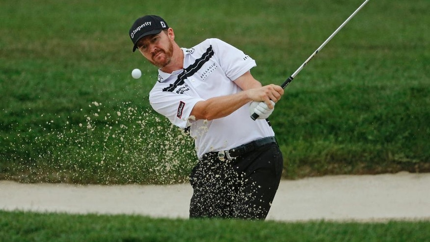 Jimmy Walker hits from a sand trap on the 10th hole during the third round of the PGA Championship golf tournament at Baltusrol Golf Club in Springfield, N.J., Sunday, July 31, 2016. (AP Photo/Mike Groll)