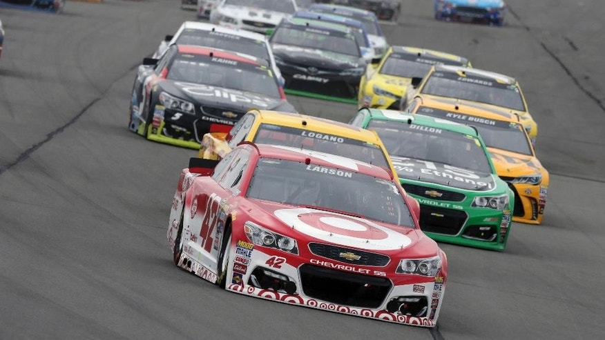 Kyle Larson (42) leads a group in the early laps of the NASCAR Sprint Cup Series Pennsylvania 400 auto race at Pocono Raceway, Monday, Aug. 1, 2016, in Long Pond, Pa. (AP Photo/Mel Evans)