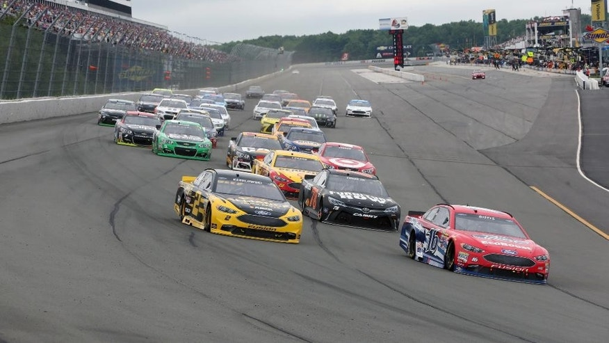 Greg Biffle (16) leads the pack on an early restart during the NASCAR Sprint Cup Series Pennsylvania 400 auto race at Pocono Raceway, Monday, Aug. 1, 2016, in Long Pond, Pa. (AP Photo/Mel Evans)