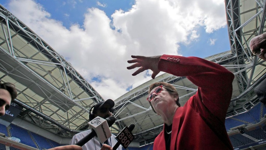 Tennis great Billie Jean King discusses the new retractable roof over Arthur Ashe Stadium, at the Billie Jean King National Tennis Center, in the Queens borough of New York, Tuesday, Aug. 2, 2016. Mother Nature will no longer be a problem at the U.S. Open as the U.S. Tennis Association unveiled the new retractable roof over Arthur Ashe Stadium. (AP Photo/Richard Drew)