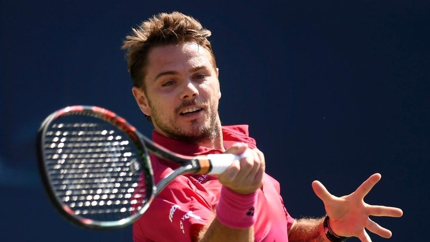 Stanislas Wawrinka, of Switzerland, returns the ball to Kei Nishikori, of Japan, during men's semifinal Rogers Cup tennis action, in Toronto on Saturday, July 30, 2016. (Frank Gunn/The Canadian Press via AP)