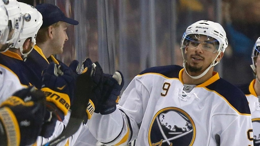 FILE - In this Dec. 26, 2015, file photo, Buffalo Sabres forward Evander Kane (9) celebrates his goal during the second period of an NHL hockey game against the Boston Bruins in Boston. Kane has pleaded not guilty, Monday, Aug. 1, 2016, in Buffalo City Court to charges alleging he grabbed three women during an altercation at a downtown bar in June.  (AP Photo/Michael Dwyer, File)