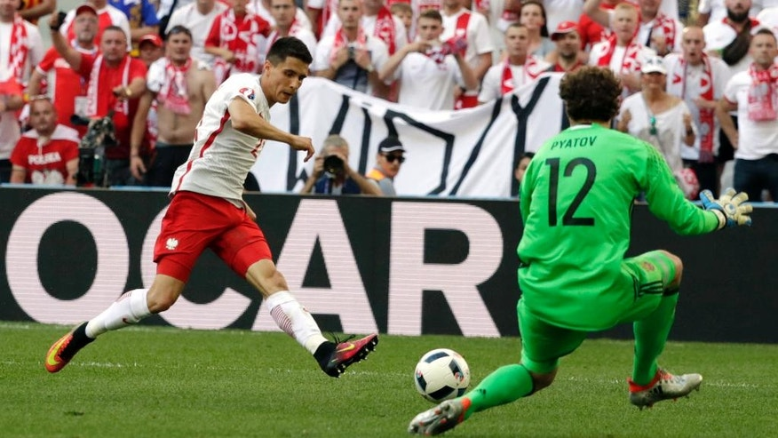 FILE - In this Tuesday, June 21, 2016 file photo, Poland's Bartosz Kapustka, left, kicks the ball in front of Ukraine goalkeeper Andriy Pyatov during the Euro 2016 Group C soccer match between Ukraine and Poland at the Velodrome stadium in Marseille, France. English Premier League champions Leicester signed Poland winger Bartosz Kapustka on Wednesday, Aug. 3, 2016, adding more depth to its squad ahead of a first appearance in European competition in 16 years. The 19-year-old Kapustka, who played at this year's European Championship, became Leicester's fifth signing of the offseason. (AP Photo/Ariel Schalit, file)