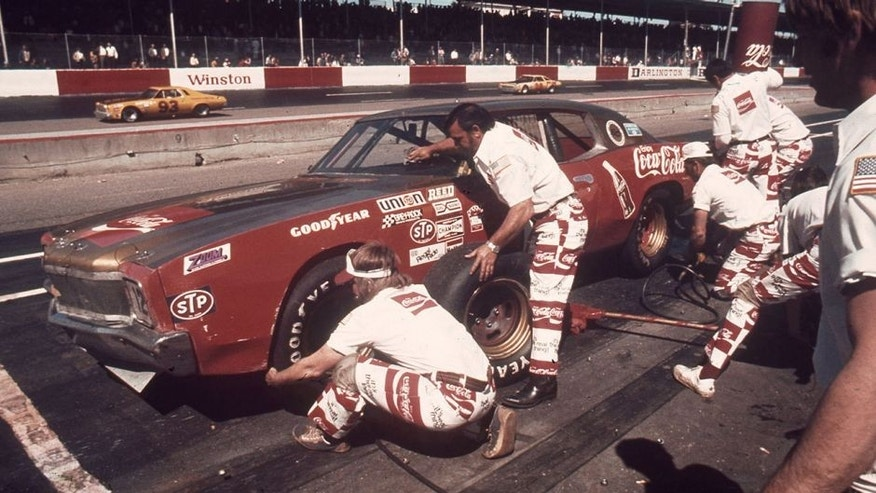 DARLINGTON, SC - 1972: Bobby Allison?s pit crew go to work on his NASCAR Cup Chevrolet during a race at Darlington Raceway wearing their unique Coca-Cola uniforms. After finishing seventh in the Rebel 300, Allison came back to win the Southern 500 at Darlington in September. (Photo by ISC Images & Archives via Getty Images)