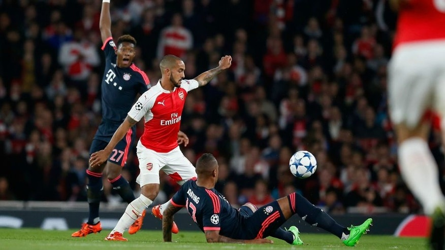 xxx of Arsenal is challenged by yyy of Bayern Munchen during the UEFA Champions League Group F match between Arsenal FC and FC Bayern Munchen at the Emirates Stadium on October 20, 2015 in London, United Kingdom.