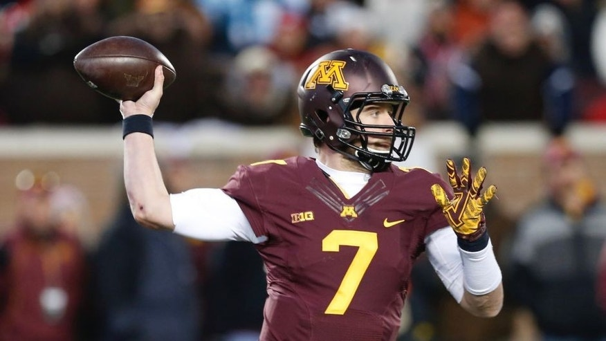 <p>In this Saturday, Nov. 28, 2015 photo, Minnesota Gophers quarterback Mitch Leidner plays against the Wisconsin Badgers in Minneapolis.</p>