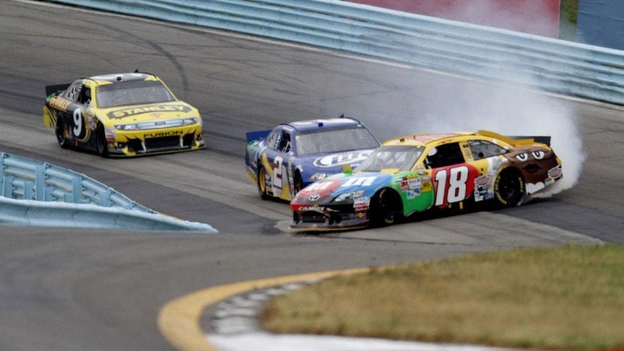 WATKINS GLEN, NY - AUGUST 12: Kyle Busch, driver of the #18 M&M's Toyota, is involved in an incident ahead of Brad Keselowski, driver of the #2 Miller Lite Dodge, and Marcos Ambrose, driver of the #9 Stanley Ford, during the NASCAR Sprint Cup Series Finger Lakes 355 at the Glen at Watkins Glen International on August 12, 2012 in Watkins Glen, New York. (Photo by Jerry Markland/Getty Images for NASCAR)