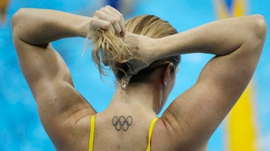 Australia's Emily Seebohm ties her hair back before a swimming training session at the 2016 Summer Olympics in Rio de Janeiro, Brazil, Tuesday, Aug. 2, 2016. (AP Photo/Matt Slocum)