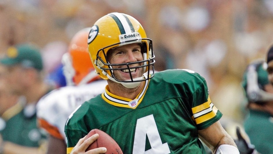 <p>Brett Favre laughs after rushing for a first down against the Cleveland Browns on Sept. 19, 2005, in Green Bay, Wis.</p>