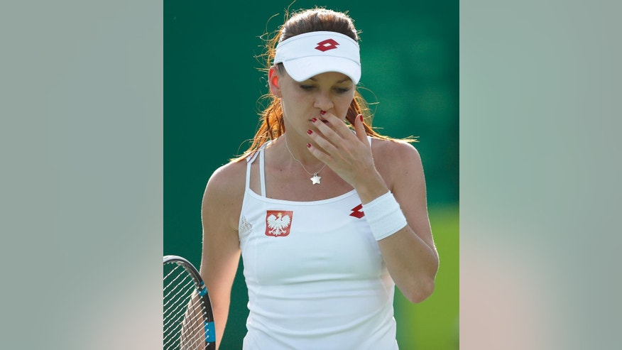 Agnieszka Radwanska of Poland reacts after losing a point during the match against China's Saisai Zheng in the women's tennis competition at the 2016 Summer Olympics in Rio de Janeiro, Brazil, Saturday, Aug. 6, 2016. (AP Photo/Vadim Ghirda)