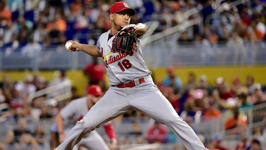 Jul 31, 2016; Miami, FL, USA; St. Louis Cardinals starting pitcher Carlos Martinez (18) delivers a pitch during the first inning against the Miami Marlins at Marlins Park. Mandatory Credit: Steve Mitchell-USA TODAY Sports