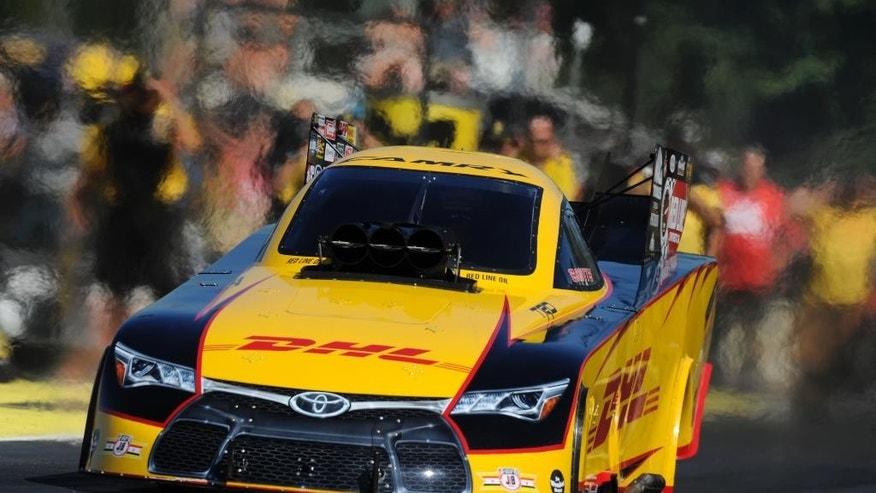 In this photo provided by NHRA, Del Worsham drives in a Funny Car qualifying at the Protect the Harvest NHRA Nationals drag races in Kent, Wash., Friday, Aug. 5, 2016. Worsham had 3.886-seconds at 327.98 mph to lead in the qualifying. (Jerry Foss/NHRA via AP)