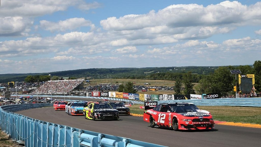 Joey Logano (12) leads the pack during the NASCAR Xfinity series auto race at Watkins Glen International, Saturday, Aug. 6, 2016, in Watkins Glen, N.Y. (AP Photo/Mel Evans)
