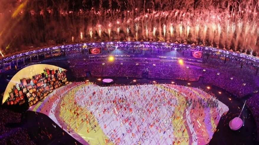 Fireworks are seen over Maracana Stadium during the opening ceremony at the 2016 Summer Olympics in Rio de Janeiro, Brazil, Friday, Aug. 5, 2016. (AP Photo/Morry Gash)