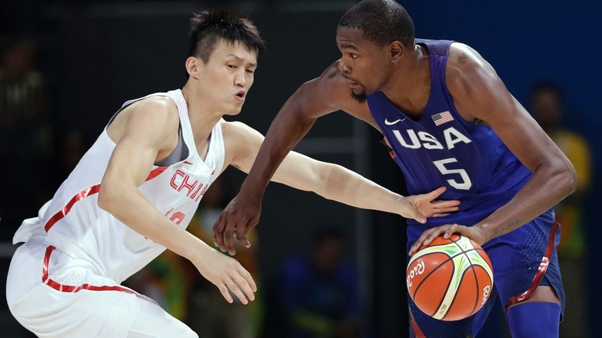 Aug. 6, 2016: United States' Kevin Durant (5) drives past China's Zou Peng, left, during a basketball game at the 2016 Summer Olympics in Rio de Janeiro, Brazil