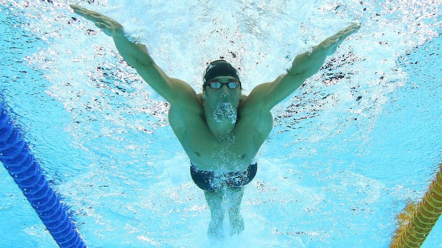 GOLD COAST, AUSTRALIA - AUGUST 24: Michael Phelps of the United States swims in the Men's 4 x 100m Medley Relay Final during day four of the 2014 Pan Pacific Championships at Gold Coast Aquatics on August 24, 2014 in Gold Coast, Australia. (Photo by Chris Hyde/Getty Images)