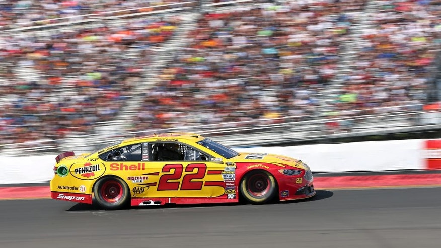 Joey Logano (22) drives out of Turn 1 during a NASCAR Sprint Cup Series auto race at Watkins Glen International, Sunday, Aug. 7, 2016, in Watkins Glen, N.Y. (AP Photo/Mel Evans)