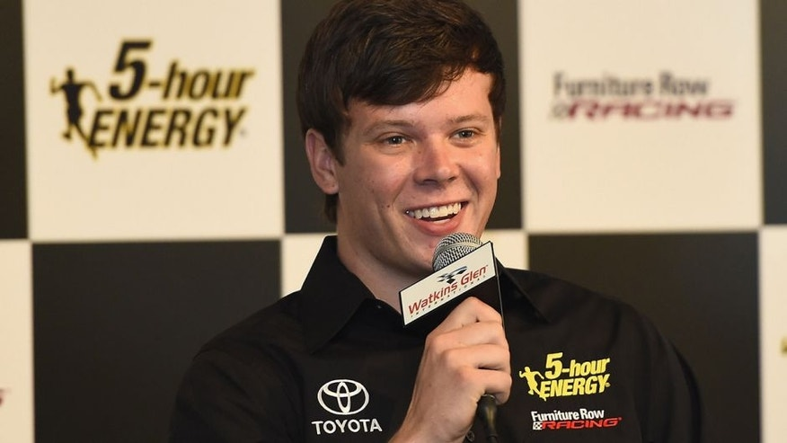 WATKINS GLEN, NY - AUGUST 07: Erik Jones speaks to the media after announcing he will drive the #77 5 -hour Energy Toyota for Furniture Row Racing in 2017 prior to the NASCAR Sprint Cup Series Cheez-It 355 at Watkins Glen International on August 7, 2016 in Watkins Glen, New York. (Photo by Josh Hedges/Getty Images)