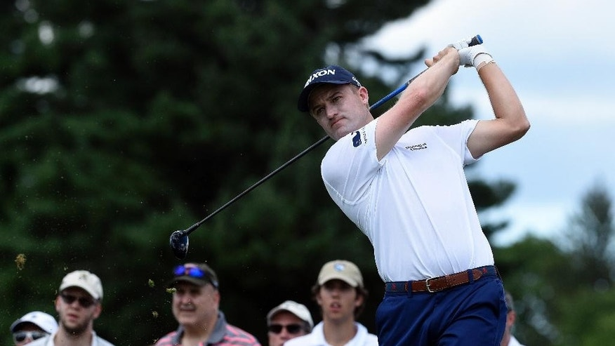 Russell Knox watches his tee shot on the second hole during the final round of the Travelers Championship golf tournament in Cromwell, Conn., Sunday, Aug. 7, 2016. (AP Photo/Fred Beckham)