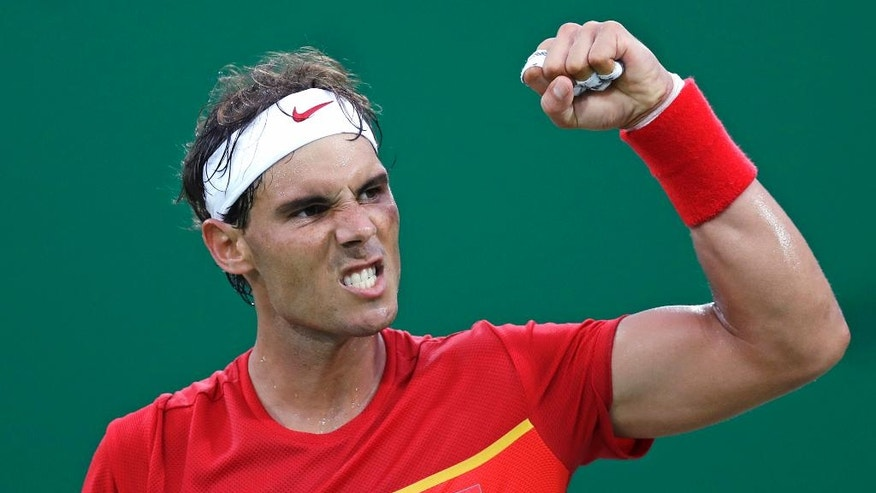 Rafael Nadal, of Spain, pumps his fist after defeating Federico Delbonis, of Argentina, at the 2016 Summer Olympics in Rio de Janeiro, Brazil, Sunday, Aug. 7, 2016. (AP Photo/Charles Krupa)