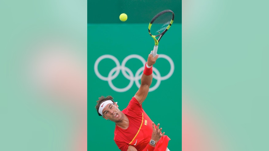 Rafael Nadal of Spain serves to Federico Delbonis of Argentina during the men's tennis competition at the 2016 Summer Olympics in Rio de Janeiro, Brazil, Sunday, Aug. 7, 2016. (AP Photo/Vadim Ghirda)