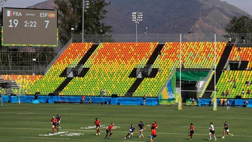 Seats sit empty during the second half of the inaugural women's rugby match between France and Spain at the Summer Olympics in Rio de Janeiro, Brazil, Saturday, Aug. 6, 2016.
