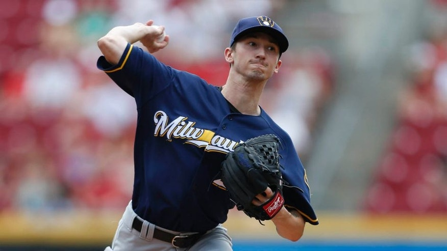 Milwaukee Brewers starting pitcher Zach Davies throws against the Cincinnati Reds during the first inning Sunday, July 17, 2016, in Cincinnati.