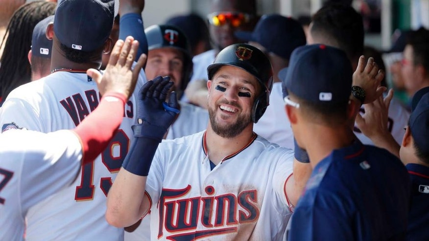 Sunday, March 13: The Minnesota Twins' Trevor Plouffe is congratulated in the dugout after his three-run home run off Baltimore Orioles starting pitcher Miguel Gonzalez in the second inning of a spring training baseball game in Fort Myers , Fla. The hit also scored Byron Buxton and Brian Dozier.