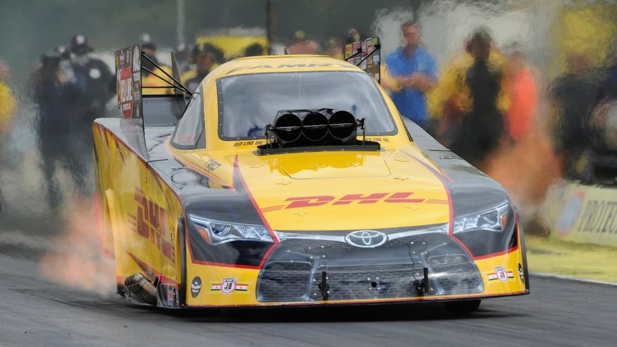 In this photo provided by NHRA, Del Worsham drives during Funny Car qualifying Saturday, Aug. 6, 2016, at the NHRA Northwest Nationals drag races at Pacific Raceways in Kent, Wash. Worsham had a time of 3.832 seconds at 330.88 mph in the fourth and final session. Worsham will face Tim Gibbons in the first round of eliminations Sunday. (Jerry Foss/NHRA via AP)