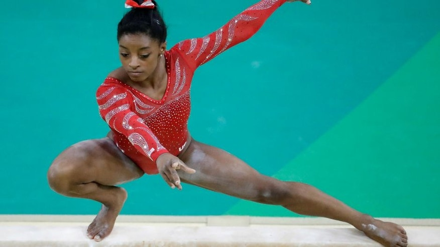 United States' Simone Biles trains on the balance beam ahead of the 2016 Summer Olympics in Rio de Janeiro, Brazil, Thursday, Aug. 4, 2016. (AP Photo/Julio Cortez)