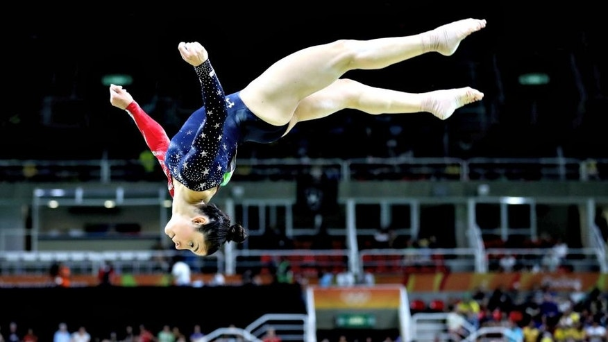 RIO DE JANEIRO, BRAZIL - AUGUST 07: Alexandra Raisman of the United States competes on the balance beam during Women's qualification for Artistic Gymnastics on Day 2 of the Rio 2016 Olympic Games at the Rio Olympic Arena on August 7, 2016 in Rio de Janeiro, Brazil (Photo by Ezra Shaw/Getty Images)